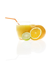 orange juice with slices and whole orange and lime