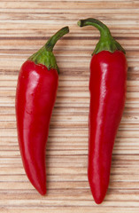 red hot peppers on wooden background
