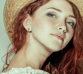 young redhead woman in countryside hat