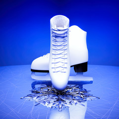 Close up view of  The skates for figure skating and a snowflake