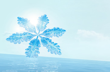 Snowflake on ice against a background of the bright blue sky.