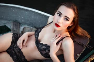 Sexy woman wearing lingerie in boat