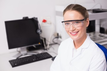 Smiling scientist looking at camera