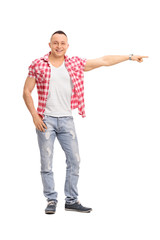 Young guy pointing right with his hand