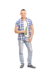 Casual young man holding a bottle of beer