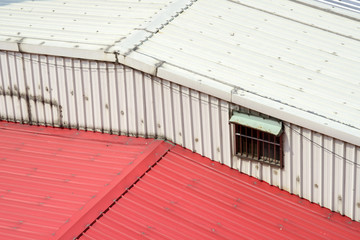 window on corrugated iron wall