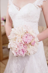Bride with a bouquet of peonies