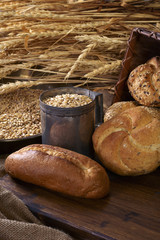 Still life of bread, wheat grains and ears
