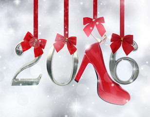 High heel shoe and 2016 number hanging on red ribbons