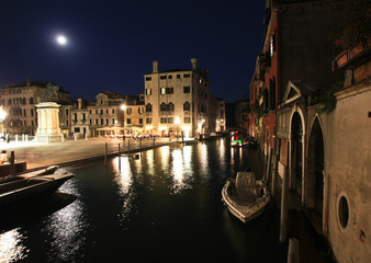 Venetian night canals with full moon
