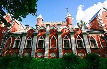Red and white mansion with fairy towers