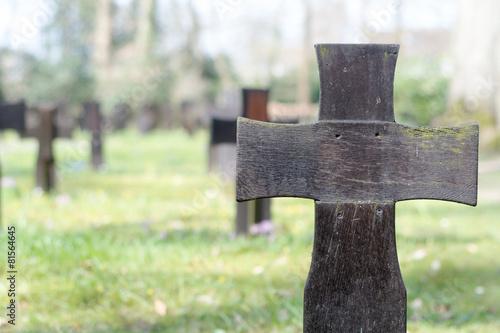 Keuken foto achterwand Olijf Dark wooden cross on a military cemetery