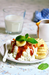 Cottage cheese with banana slices and caramel sauce.