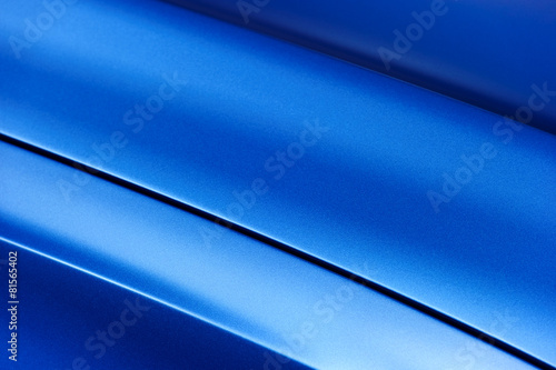 Surface of blue sport sedan car metal hood; vehicle bodywork - 81565402