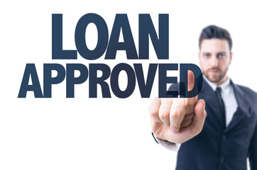 Business man pointing the text: Loan Approved