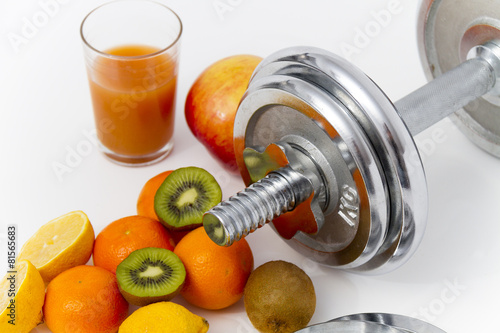 Fitness equipment and healthy food, apple, nectarines, kiwi, lem - 81565683