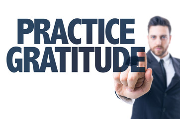 Business man pointing the text: Practice Gratitude