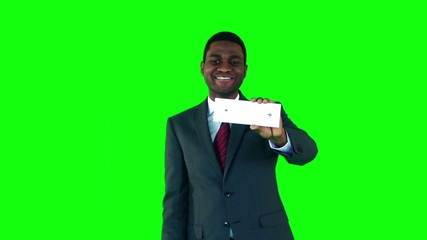 Smiling businessman showing cards