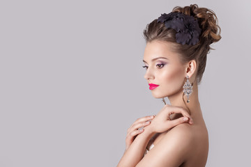 girl with a gentle evening hairstyles with flowers in their hair
