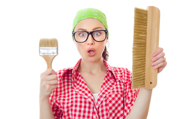 Surprised woman holding paint brush