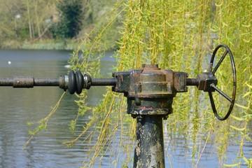 Vintage lock mechanism by pond