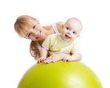 Fototapety mother and her baby having fun with gymnastic ball
