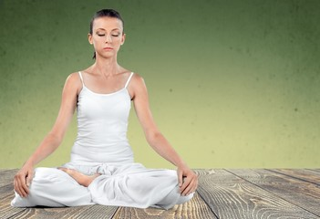 Yoga. Young woman doing meditation