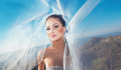 Portrait of a bride with veil on wind