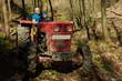 Lumberjack on his logging tractor