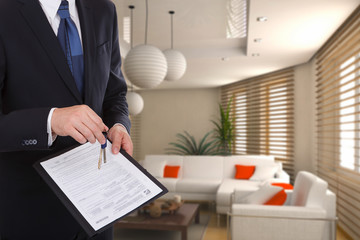 Businessman gives keys for the contract