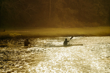 youngs in canoe paddling in the river in Galicia Spain