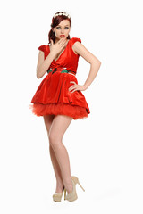 Beautiful woman in a red dress posing on a white background