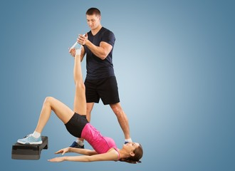 Trainer. Personal trainer man coach and woman exercising