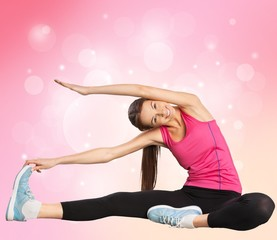 Stretching. Smiling woman with high body flexibility exercising