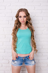 girl in shorts and a T-shirt with long hair