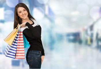 Shopping. Beautiful girl with her shopping bags