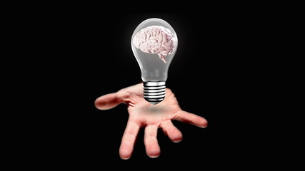 Hand presenting light bulb with brain