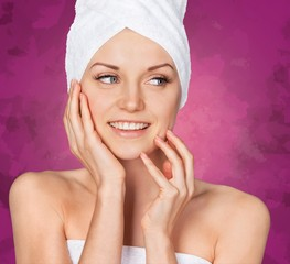 Spa Treatment. Smiling Woman Getting a Facial Treatment