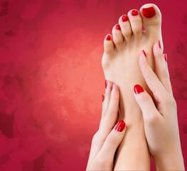Spa. Closeup photo of a female feet with beautiful red pedicure
