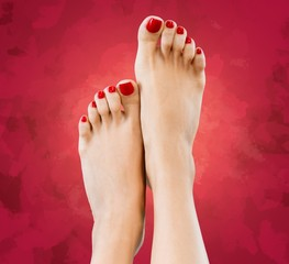 Red. Closeup photo of a beautiful female feet with red pedicure