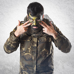 Soldier with face painted