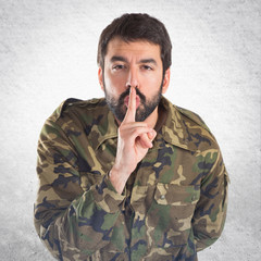 Soldier making silence gesture
