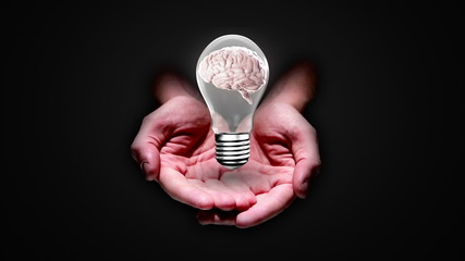 Hands presenting light bulb with brain