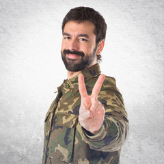 Soldier doing victory gesture