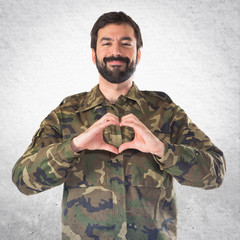 Soldier making a heart with his hands
