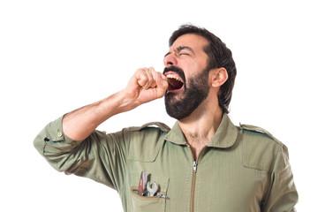 Mechanic yawning over white background
