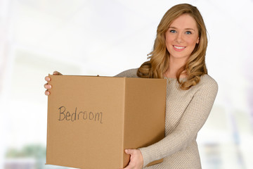 Young woman moving in