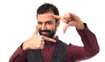 Man wearing waistcoat focusing with his fingers