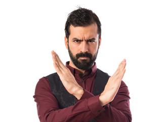 Man wearing waistcoat doing NO gesture