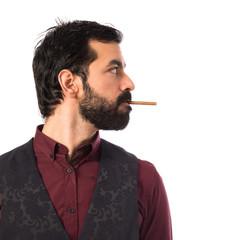 Man wearing waistcoat smoking
